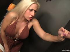 Beautiful tattooed blonde with nice big tits sucking a cock through a glory hole