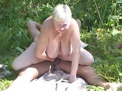 Sultry granny delivers a sloppy blowjob then gets nailed outdoors
