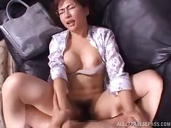 Very sexy Japanese babe in glasses enjoys this dong banging her hairy muff in POV