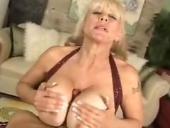 Horny granny with big tits gives great titjob