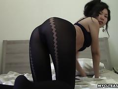 Small tits Asian amateur teases in her pretty black pantyhose