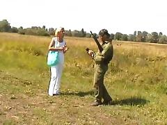 Hot blonde meets a soldier and fucks him in a field