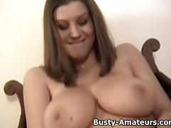 Busty Sara mastubates her pussy with huge dildo