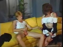 Hipster fucks shemale in highboots in classic porn video