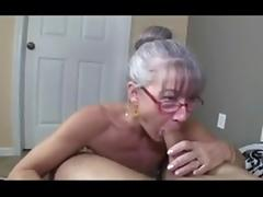 Skinny greyhaired granny sucks  cock