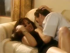 Beautiful MILF takes the young boy home to fulfill her needs