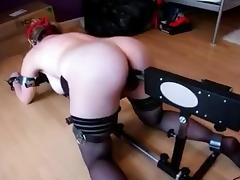 Redhead tied on the floor spanked and fucked by machine