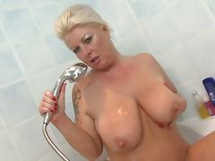 Mature bitch with saggy boobs having solo fun in the shower