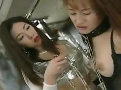 Two Japanese lesbians fuck with a strapon