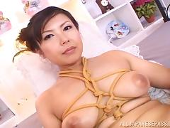 Super busty Asian MILF likes light bondage and all things kinky
