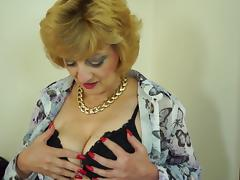 Fabulous blonde mature woman in lingerie masturbating
