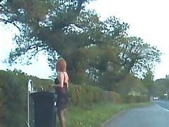 Amateur crossdresser in lingerie outdoors