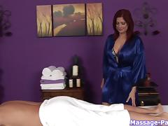 Talented masseuse with sexy red hair sucks his big cock