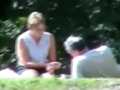 Voyeur tapes a slut wife having sex with 3 guys in the park