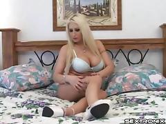 Bimbo implants are round and sexy as the solo blonde plays