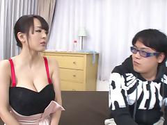 Very busty Asian babe jerks a guy off all over her big melons