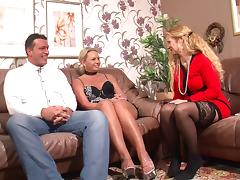 Two older women suck and sit on a younger guy's cock