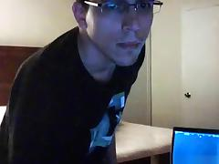 Nerd sets up a cam and gets a handjob from a girl