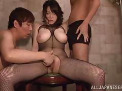 japanese beauty in fishnets has huge, ample boobs