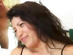 Milf with fishnet lingerie sucks her man's cock and balls pov in the bathroom