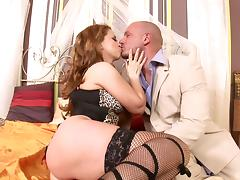 Big man and a babe in fishnet stockings fuck wildly