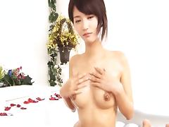 Bikini clad Asian hottie gives her clients erotic massages with happy endings