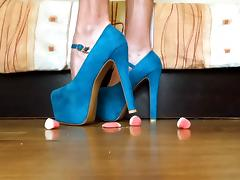 Crushing jelly bonbons with high heels