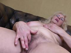 Saggy boobs granny gets naked and masturbates her hairy box