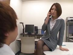 Astonishing Japanese brunette gives a stunning handjob in the office