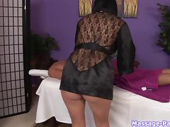 Leggy masseuse in soft black satin gives a great blowjob