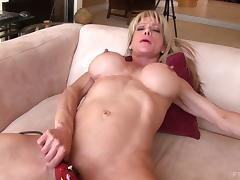 Glorious big round fake tits on a hot milf that fucks a toy