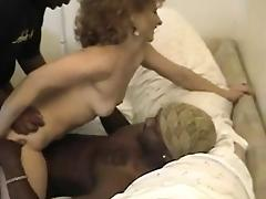Redhead wife playing with two big black cocks