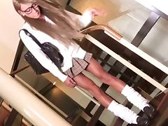 Japanese tranny in glasses and a miniskirt jerks off