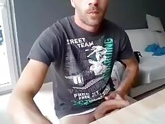 Lovely fag is playing in a small room and filming himself on webcam