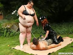 Mistress and her SSBBW friend fuck a submissive slave guy outdoors