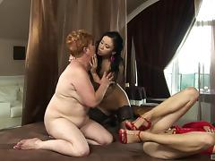 Bombastic black-haired chick licks the pussy of her experienced mentor