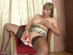 Hot mom takes off her satin panties and fucks her dildo