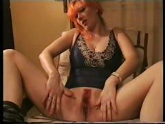 Red haired skinny housewife struts her stuff and masturbates