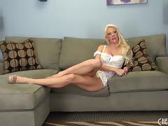 Slutty blonde bimbo babe with huge fake tits masturbates