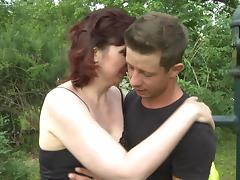 Sex in the grass with a mature redhead and a college guy