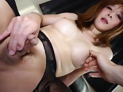 Japanese shemale in sexy stockings strokes her big dick