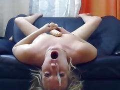 Russian slut fucks her throat with her dildo