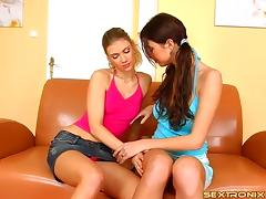 Buxom lesbian couple drill each other's cunts with toys on the couch