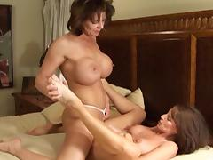 Milfs with incredible big tits have passionate strapon sex