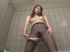 Japanese girl in transparent pantyhose gets the bathroom masturbation