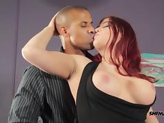 Sexy redhead shemale allows the exotic guy to explore her asshole