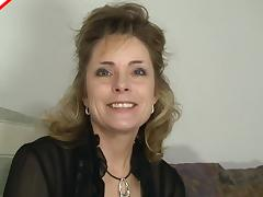 Pretty mature slut in a black blouse sucks dick sensually