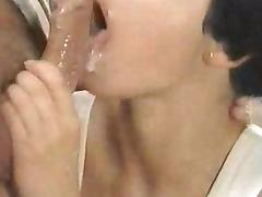 Cute brunette with short hair swallows cum