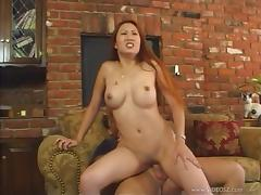 Asian chick with the red hair tries out the joys of the anal drilling