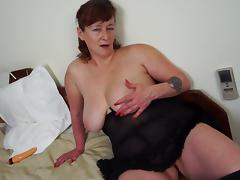 Tattooed matured granny smashing her juicy pussy using massive toy